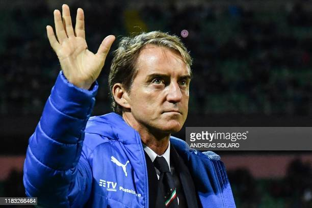 Italy's coach Roberto Mancini waves prior to the Euro 2020 1st round Group J qualifying football match Italy v Armenia on November 18 2019 at the...