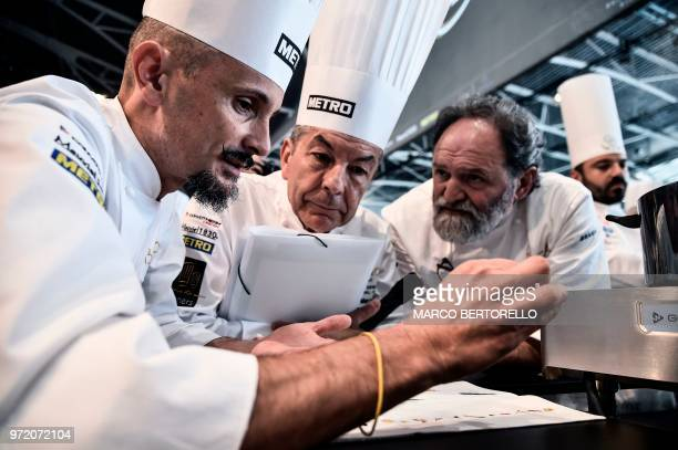 Italy's committee member Enrico Crippa shows the Italian menu during the event of the Bocuse d'Or Europe 2018 International culinary competition on...