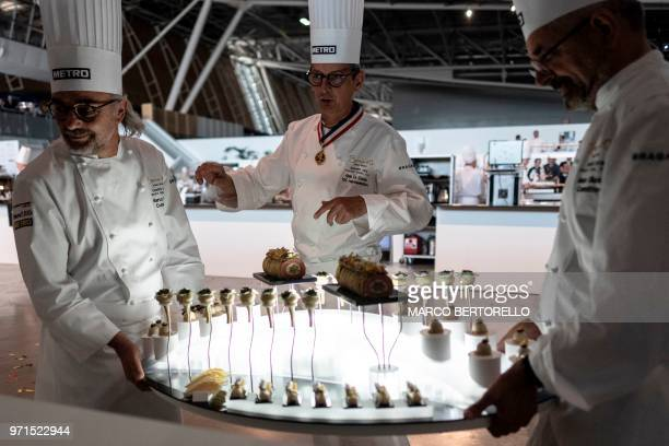 Italy's committee members hold a dish during the Europe 2018 Bocuse d'Or International culinary competition on June 11 2018 in Turin