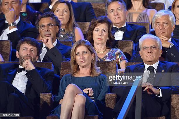 Italy's Culture Minister Dario Franceschini Italian President Sergio Mattarella and his daughter Laura attend the opening of the 72nd Venice...
