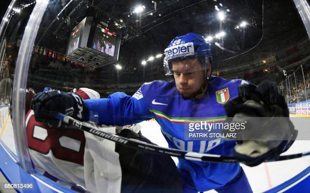 Italy´s Daniel Glira and Latvia´s Gints Meija vie during the IIHF Ice Hockey World Championships first round match between Italy and Latvia in...