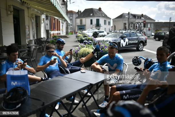 Italy's Daniele Bennati Spain's Mikel Landa Spain's Alejandro Valverde Spain's Jose Joaquin Rojas and Costa Rica's Audrey Amador take a break at a...