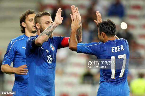 Italy's Daniele De Rossi celebrates after scoring a goal with Italy's Eder during the friendly football match Italy vs Uruguay at the Allianz Riviera...