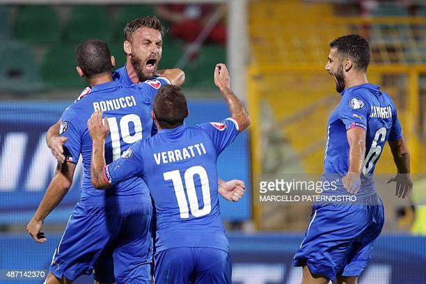 Italy's Daniele De Rossi is congratulated by teammates after scoring during the Euro 2016 qualifying football match between Italy and Bulgaria at the...