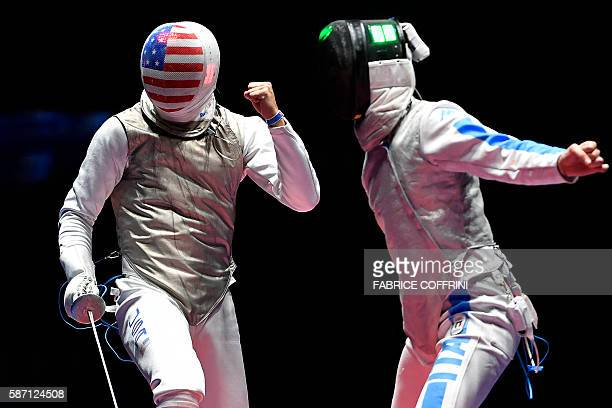 Italy's Daniele Garozzo and US Alexander Massialas react during the mens individual foil gold medal bout as part of the fencing event of the Rio 2016...