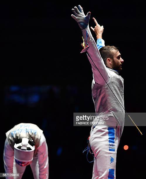 Italy's Daniele Garozzo celebrates as US Alexander Massialas reacts after during the mens individual foil gold medal bout as part of the fencing...