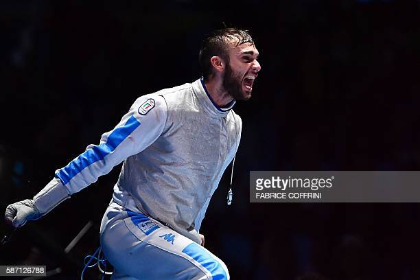 Italy's Daniele Garozzo celebrates celebrates winning against as US Alexander Massialas in the mens individual foil gold medal bout as part of the...