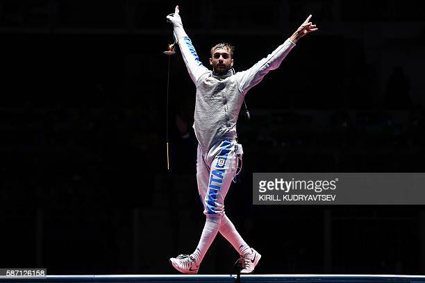 Italy's Daniele Garozzo celebrates winning against US Alexander Massialas after the mens individual foil gold medal bout as part of the fencing event...