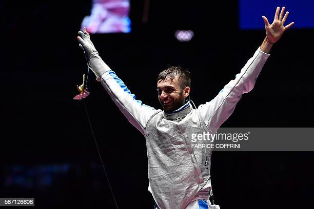 Italy's Daniele Garozzo celebrates winning against US Alexander Massialas after during the mens individual foil gold medal bout as part of the...