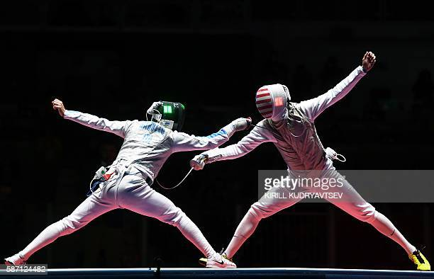 Italy's Daniele Garozzo competes against competes against US Alexander Massialas during the mens individual foil gold medal bout as part of the...