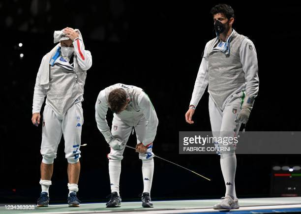 Italy's Daniele Garozzo reacts after loosing against Japan's Kyosuke Matsuyama in the mens team foil quarter-final bout during the Tokyo 2020 Olympic...