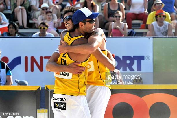 Italy's Daniele Lupo and Nicolai Paolo celebrate their victory during the NicolaiLupo v GabathulerWeingart game as part of the FIVB Gstaad Grand Slam...
