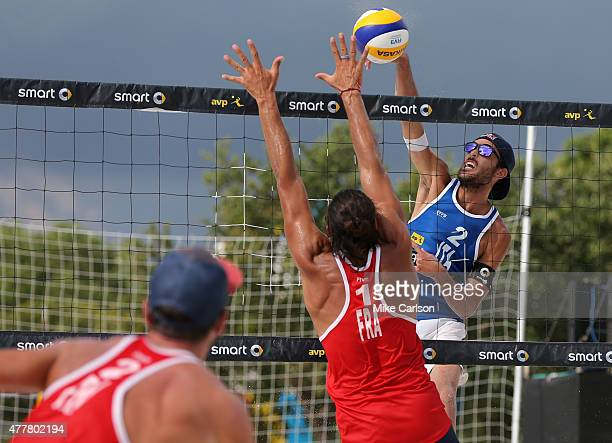 Italy's Daniele Lupo attempts to hit past France's Youssef Krou at the FIVB St Petersburg Grand Slam on June 19 2015 in St Petersburg Florida