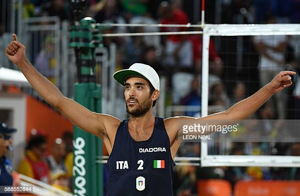 Italy's Daniele Lupo celebrates after winning a point during the men's beach volleyball qualifying match between USA and Italy at the Beach Volley...