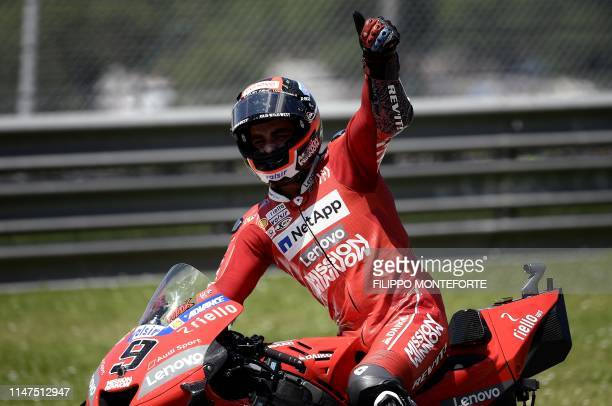 Italy's Danilo Petrucci celebrates after winning the Italian Moto GP Grand Prix at the Mugello race track on June 2 2019 in Scarperia e San Piero
