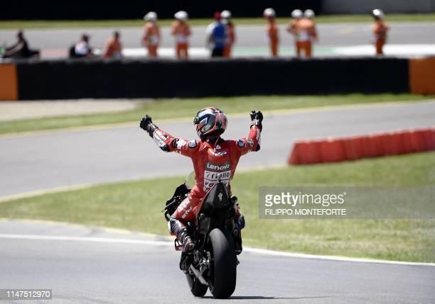 Italy's Danilo Petrucci celebrates after winning the Italian Moto GP Grand Prix at the Mugello race track on June 2 2019 in Scarperia e San Piero