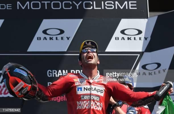 TOPSHOT Italy's Danilo Petrucci celebrates on the podium after winning the Italian Moto GP Grand Prix at the Mugello race track on June 2 2019 in...