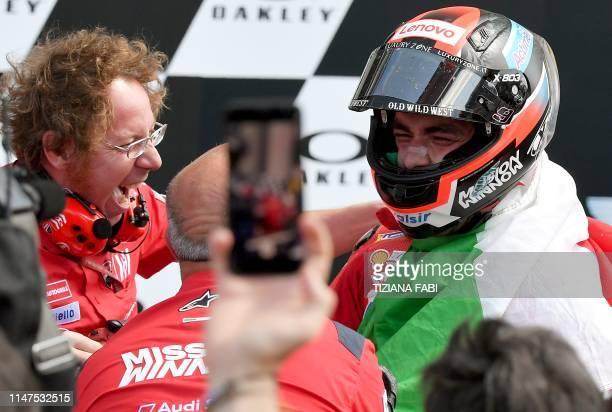 Italy's Danilo Petrucci celebrates with his team after winning the Italian Moto GP Grand Prix at the Mugello race track on June 2 2019 in Scarperia e...