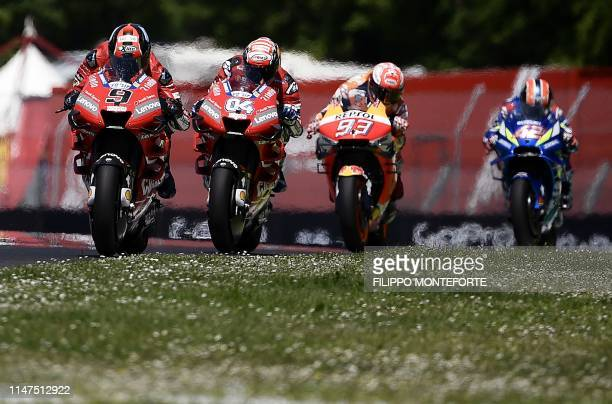TOPSHOT Italy's Danilo Petrucci Italy's Andrea Dovizioso Spain's Marc Marquez and Spain's Alex Rins ride during the Italian Moto GP Grand Prix at the...