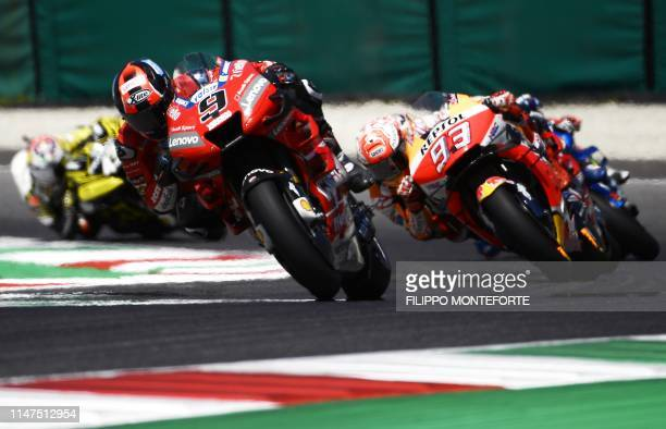 TOPSHOT Italy's Danilo Petrucci rides Ducati ahead of Spain's Marc Marquez riding his Honda during the Italian Moto GP Grand Prix at the Mugello race...