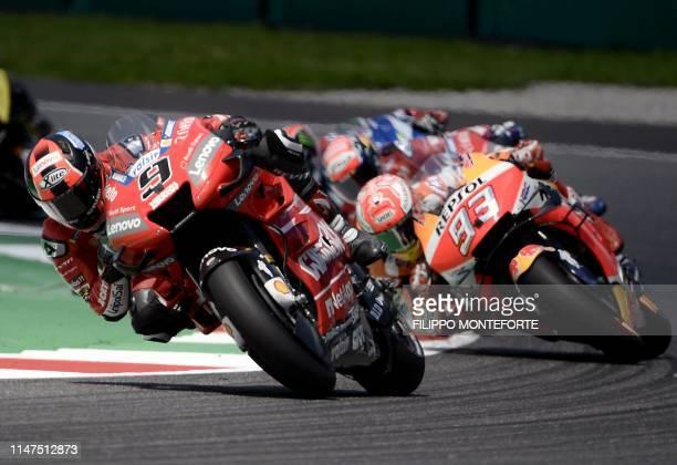 Italy's Danilo Petrucci rides his Ducati ahead of Spain's Marc Marquez riding his Honda during the Italian Moto GP Grand Prix at the Mugello race...