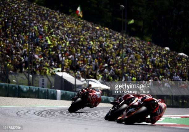 TOPSHOT Italy's Danilo Petrucci rides his Ducati during the Italian Moto GP Grand Prix at the Mugello race track on June 2 2019 in Scarperia e San...
