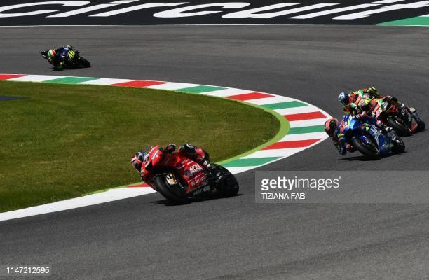 Italy's Danilo Petrucci rides his Ducati followed by Spain's Alex Rins riding his Suzuki Spain's Aleix Espargaro riding his Aprilia and Italy's...