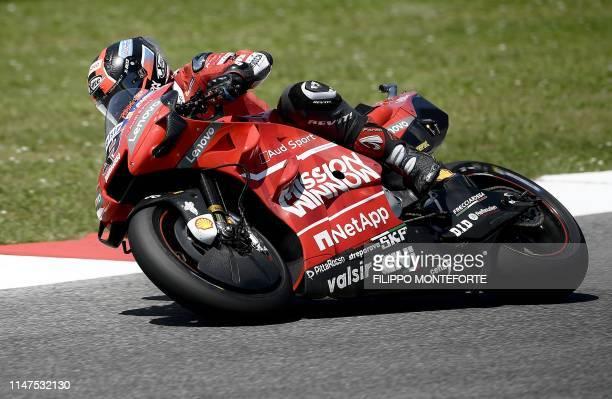 Italy's Danilo Petrucci rides his Ducati on his way to winning the Italian Moto GP Grand Prix at the Mugello race track on June 2 2019 in Scarperia e...