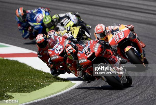 Italy's Danilo Petrucci riding his Ducati Italy's Andrea Dovizioso riding his Ducati and Spain's Marc Marquez riding his Honda compete during the...