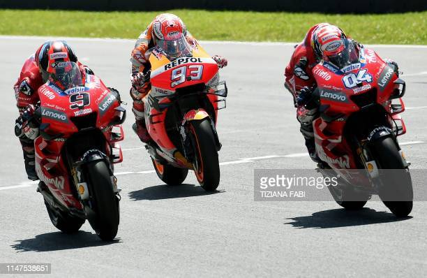 Italy's Danilo Petrucci Spain's Marc Marquez and Italy's Andrea Dovizioso compete during the Italian Moto GP Grand Prix at the Mugello race track on...