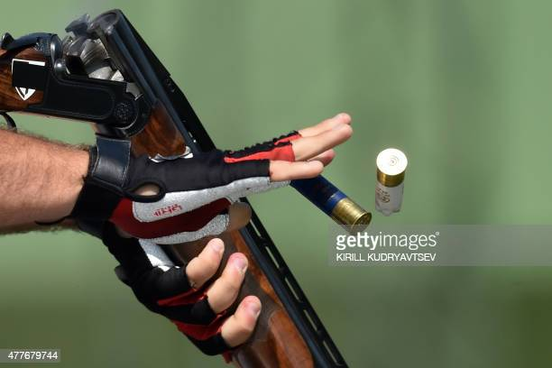 Italy's Davide Gasparini competes in the men's double trap qualification at the 2015 European Games in Baku on June 19, 2015. AFP PHOTO / KIRILL...