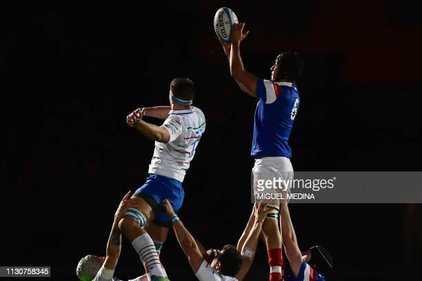 Italy's Davide Ruggeri and France's Number 8 Mathieu Hirigoyen go for the ball in a line out during the Under-20 Six Nations international rugby...