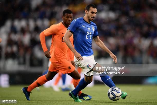 Italy's Davide Zappacosta vies for the ball with Netherlands' midfielder Georgino Wijnaldum during the international friendly football match between...