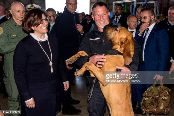 Italy's Defence Minister Elisabetta Trenta with Zagor a dog to the Carabinieri with whom the head of government entertained at Pratica di Mare after...