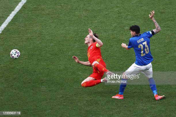 Italy's defender Alessandro Bastoni fouls Wales' forward Gareth Bale during the UEFA EURO 2020 Group A football match between Italy and Wales at the...