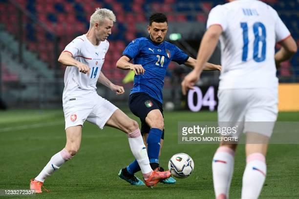 Italy's defender Alessandro Florenzi challenges Czech Republic's midfielder Jakub Jankto on June 04, 2021 during the international friendly football...
