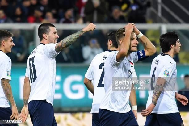 Italy's defender Alessio Romagnoli celebrates next to Italy's forward Ciro Immobile after scoring during the Euro 2020 1st round Group J qualifying...