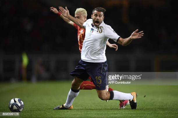 Italy's defender Andrea Barzagli reacts next to Macedonia's defender Ezgjan Alioski during the FIFA World Cup 2018 qualification football match...