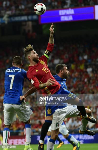 Italy's defender Andrea Barzagli vies with Spain's defender Sergio Ramos during the World Cup 2018 qualifier football match between Spain and Italy...