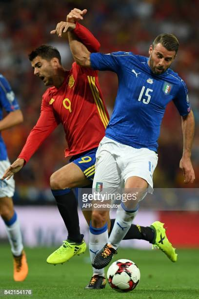 Italy's defender Andrea Barzagli vies with Spain's forward Alvaro Morata during the World Cup 2018 qualifier football match Spain vs Italy at the...