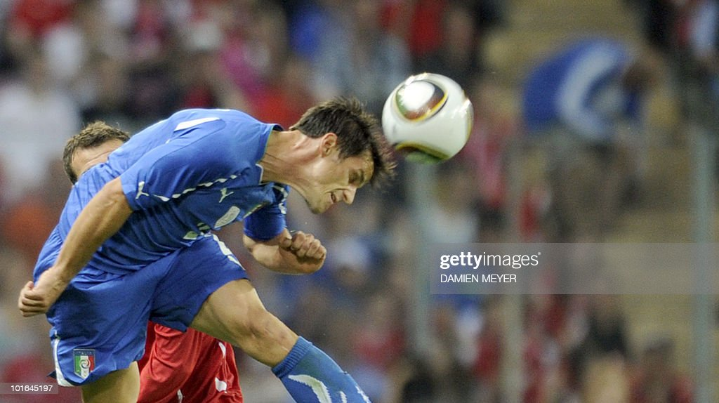 Italy's defender Christian Maggio heads the ball despite Switzerland's forward and captain Alexander Frei during the friendly football match Switzerland vs Italy at Geneva's stadium on June 5, 2010 ahead of the FIFA 2010 World Cup in South Africa.