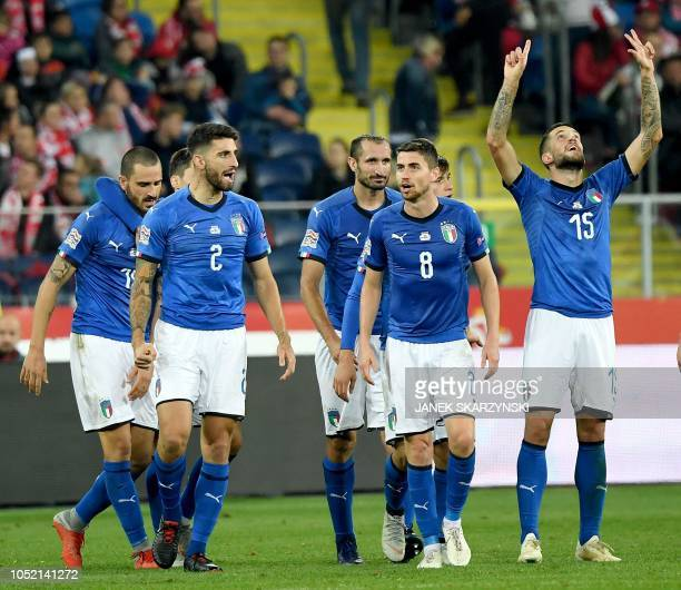 Italy's defender Cristiano Biraghi celebrates scoring with his teammates during the UEFA Nations League football match Poland v Italy at the Silesian...