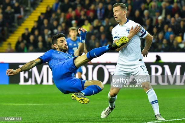 Italy's defender Cristiano Piccini kicks the ball under pressure from Finland's midfielder Juha Pirinen during the Euro 2020 Group J qualifying...