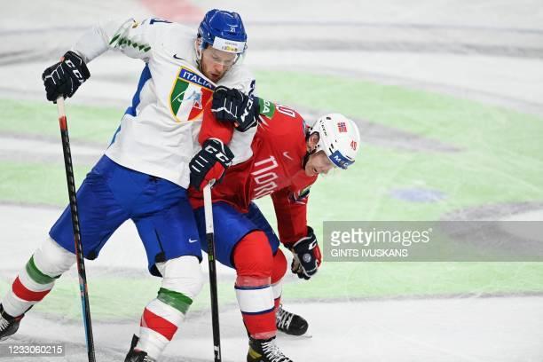 Italy's defender Daniel Glira and Norway's forward Ken Andre Olimb vie during the IIHF Men's Ice Hockey World Championships preliminary round group B...
