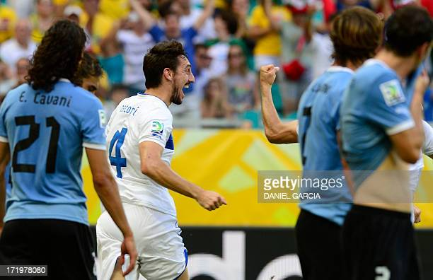 Italy's defender Davide Astori celebrates after tapping home a free kick by midfielder Alessandro Diamanti which rebounded on the back of Uruguay's...