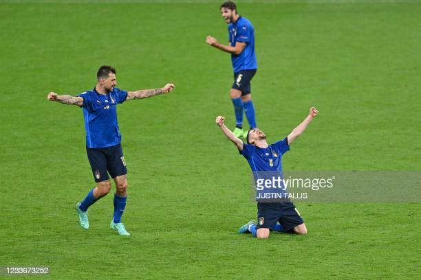 Italy's defender Francesco Acerbi and Italy's midfielder Jorginho celebrate after extra-time in the UEFA EURO 2020 round of 16 football match between...