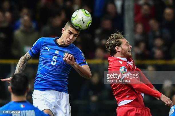 Italy's defender Gianluca Mancini and Liechtenstein's forward Nicolas Hasler go for a header during the Euro 2020 Group J qualifying football match...