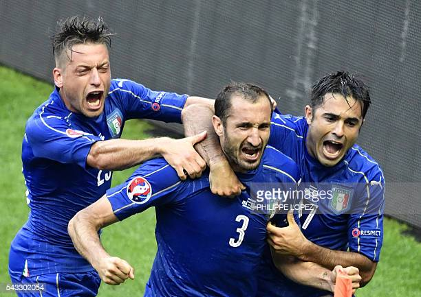 Italy's defender Giorgio Chiellini celebrates a goal with Italy's midfielder Emanuele Giaccherini and Italy's forward Citadin Martins Eder during the...