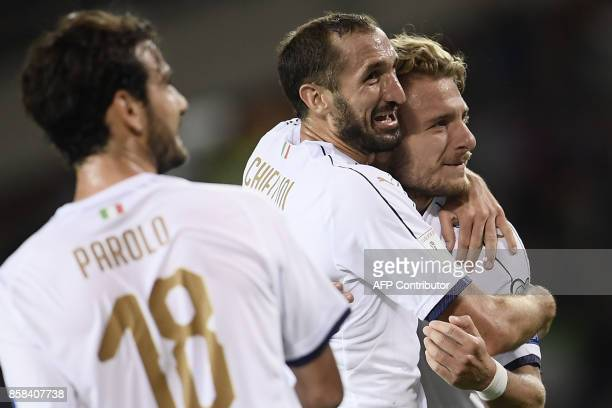Italy's defender Giorgio Chiellini celebrates after scoring with Italy's midfielder Ciro Immobile during the FIFA World Cup 2018 qualification...