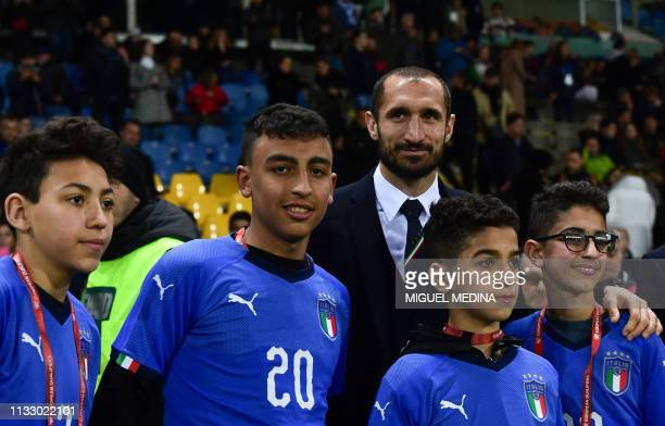 Italy's defender Giorgio Chiellini poses with schoolchildren Adam Ramy Shehata and two others who helped police after being taken hostage during a...